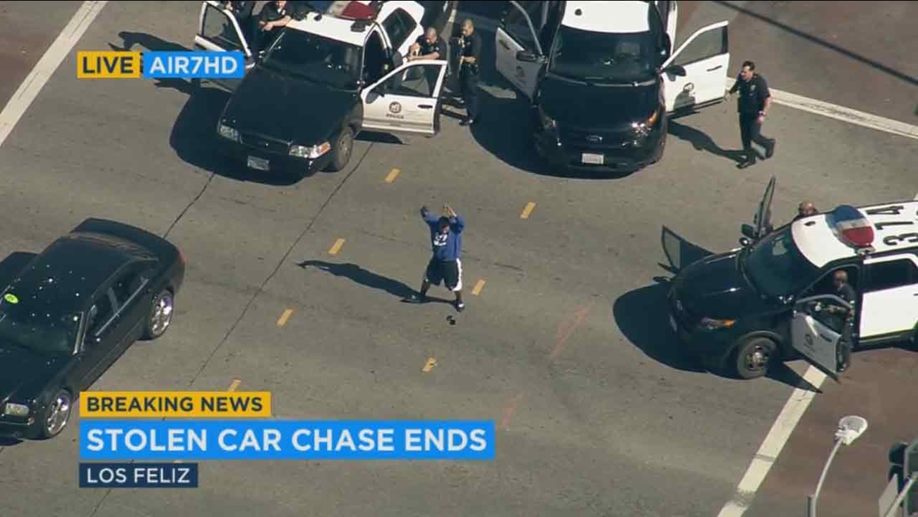 A suspect surrenders to police following a car chase from South Los Angeles to Los Feliz on Thursday, Feb. 4, 2016.