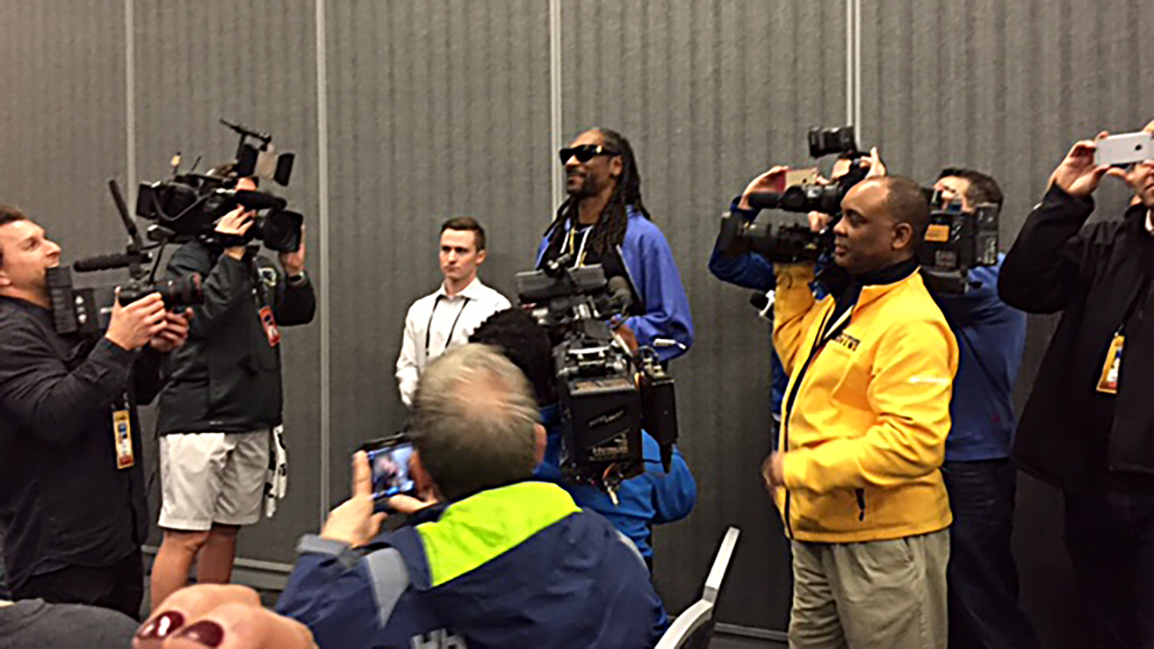 Snoop Dogg visits with the Panthers at their press conference Thursday.