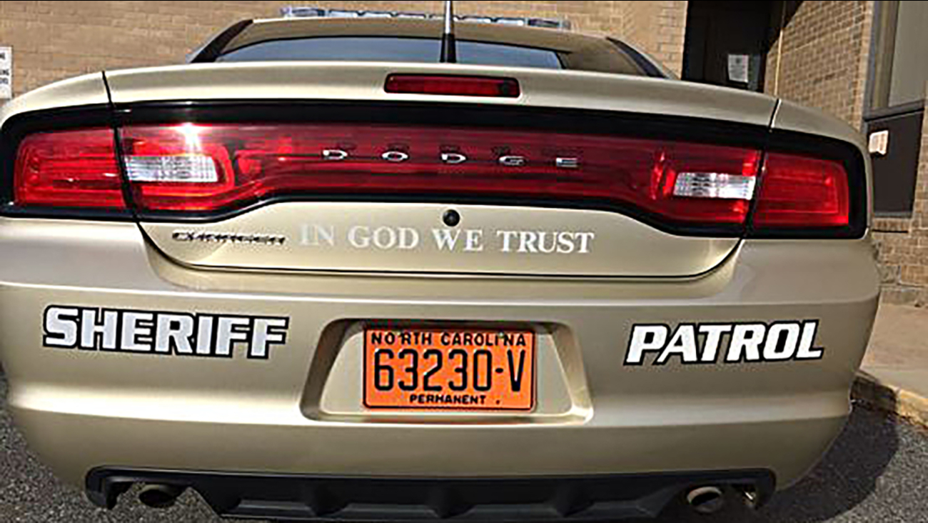 """Patrol cars in one western North Carolina county will soon display decals saying """"In God We Trust."""""""