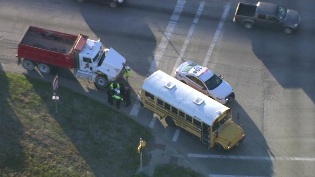 Bus, dump truck crash in east Harris County