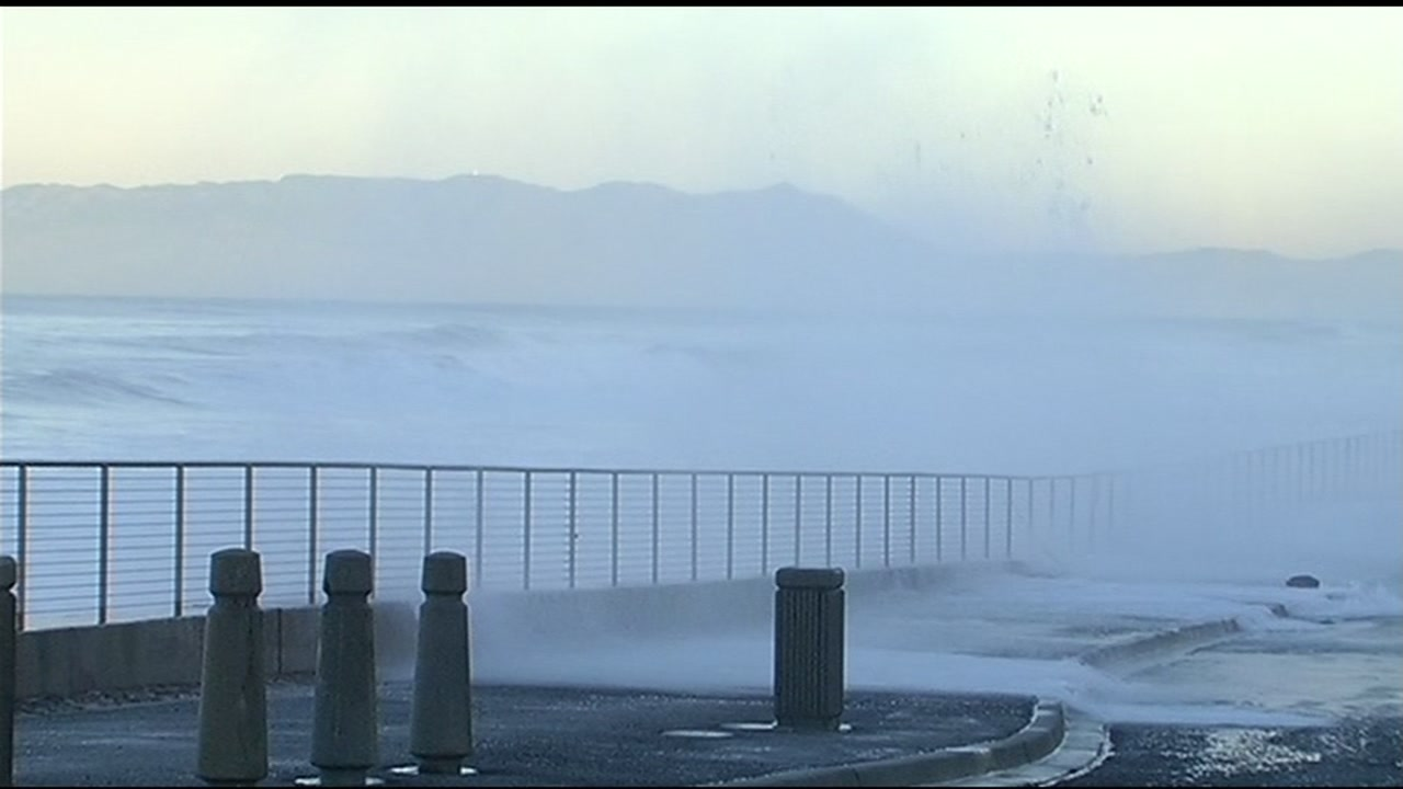 Strong waves break over the seawall in Pacifica, Calif. on Friday, February 5, 2016.