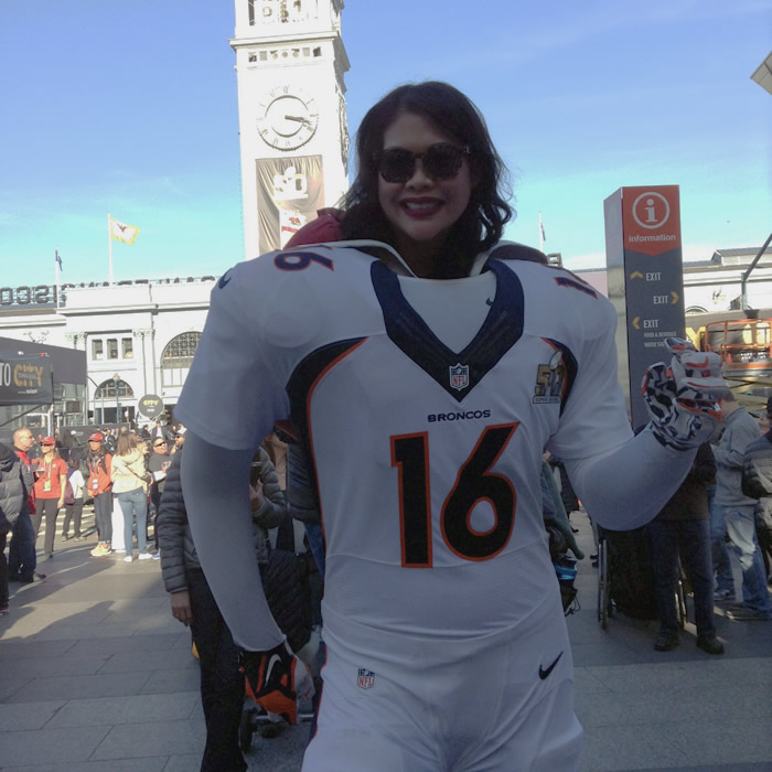 "<div class=""meta image-caption""><div class=""origin-logo origin-image none""><span>none</span></div><span class=""caption-text"">A Denver Broncos fan smiles as she has her photo taken at Super Bowl City in San Francisco, Calif. on February 5, 2016. (KGO-TV)</span></div>"