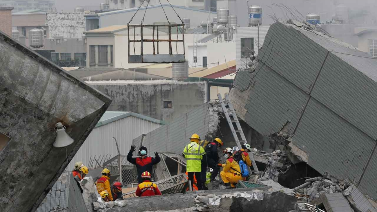 Rescue teams continue to search for the missing in a collapsed building, after an early morning earthquake in Tainan, Taiwan, Saturday, Feb. 6, 2016.