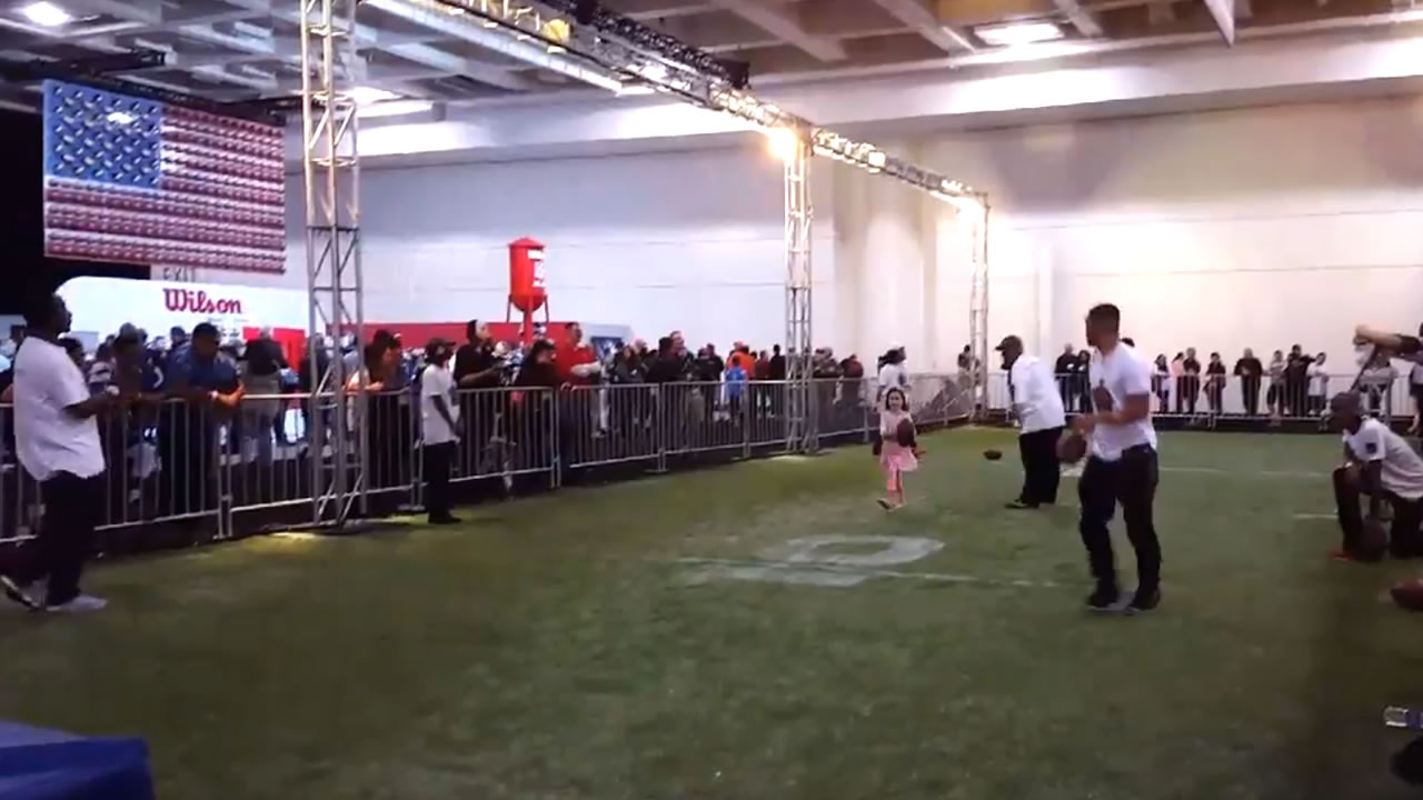 A little girl practices drills at NFL Experience in San Francisco on Saturday, February 6, 2016.