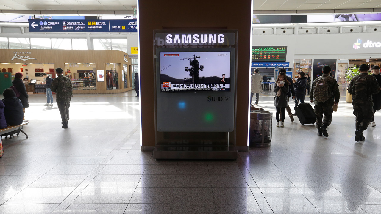 A TV screen shows file footage about North Korea's rocket launch plans at Seoul Railway Station in Seoul, South Korea, Friday, Feb. 5, 2016.