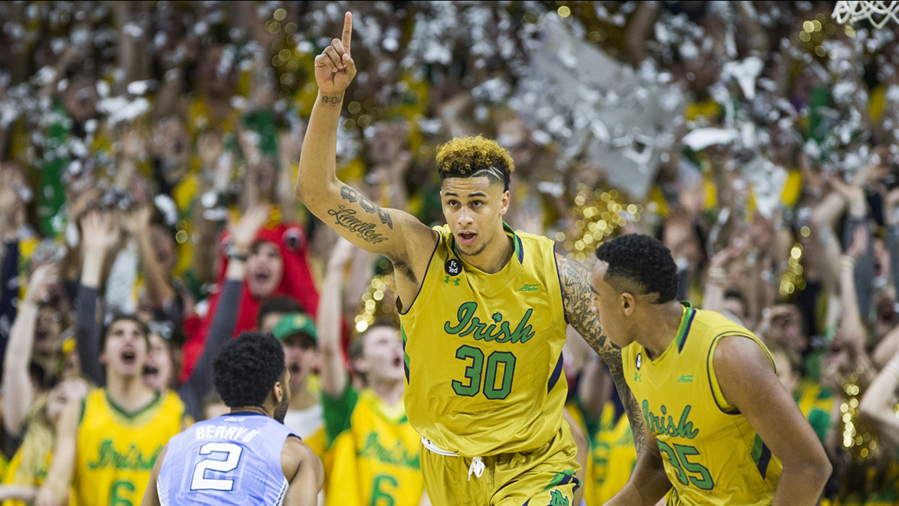 Notre Dame's Zach Auguste (30) celebrates after scoring the team's first basket of the night against North Carolina, in an NCAA college basketball game Saturday, Feb. 6, 2016