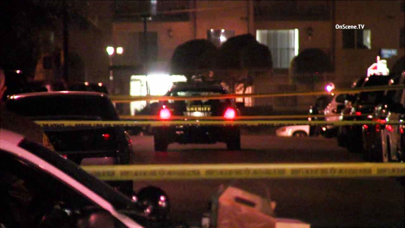 Los Angeles County sheriff's deputies on scene of a quadruple shooting in an unincorporated area of Los Angeles on Saturday, Feb. 6, 2016.