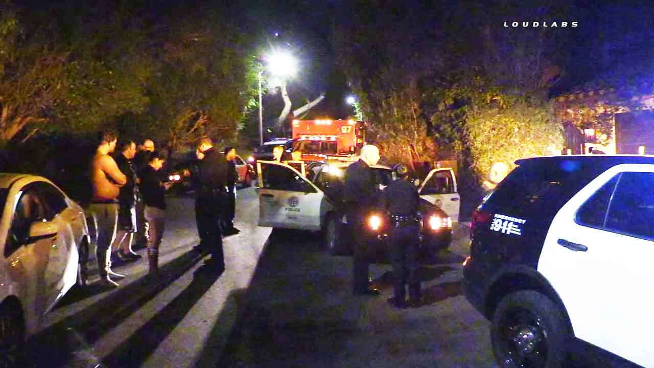 LAPD officers at the scene of a home-invasion robbery in Hollywood Hills on Saturday, Feb. 7, 2016.