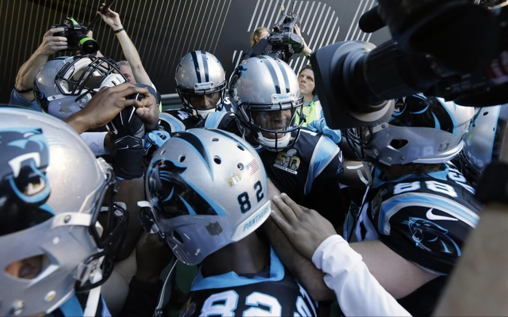 "<div class=""meta image-caption""><div class=""origin-logo origin-image none""><span>none</span></div><span class=""caption-text"">Carolina Panthers' Cam Newton (1) huddles with teammates before the NFL Super Bowl 50 football game against the Denver Broncos Sunday, Feb. 7, 2016, in Santa Clara, Calif. (AP Photo/Gregory Bull)</span></div>"