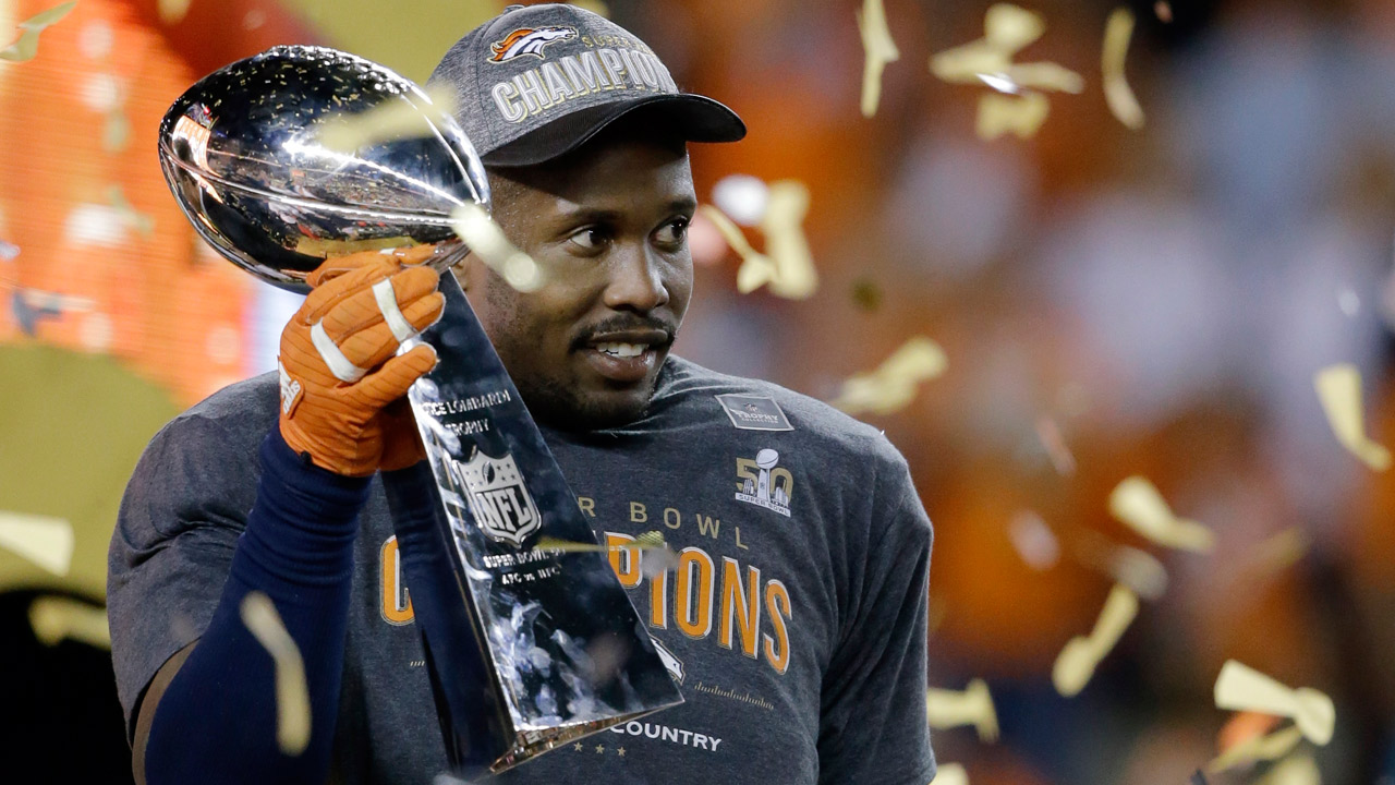 Denver Broncos' Von Miller holds the Lombardi Trophy after the NFL Super Bowl 50 football game against the Carolina Panthers, Sunday, Feb. 7, 2016, in Santa Clara, Calif.