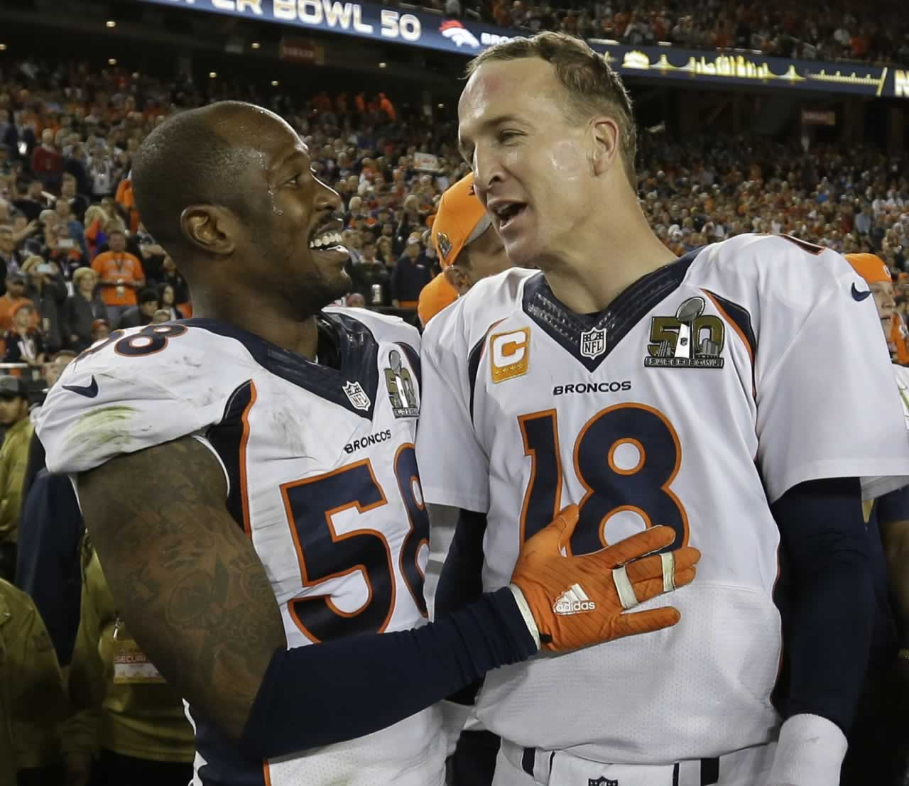 "<div class=""meta image-caption""><div class=""origin-logo origin-image none""><span>none</span></div><span class=""caption-text"">Denver Broncos' Von Miller (58) and Peyton Manning (18) celebrate after the NFL Super Bowl 50 football game Sunday, Feb. 7, 2016, in Santa Clara, Calif. (AP Photo/David J. Phillip)</span></div>"