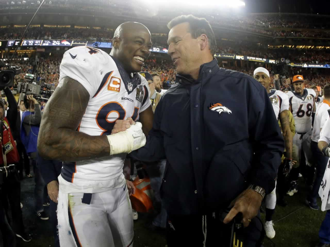 "<div class=""meta image-caption""><div class=""origin-logo origin-image none""><span>none</span></div><span class=""caption-text"">Broncos' DeMarcus Ware, head coach Gary Kubiak celebrate after their win against the Panthers in the NFL Super Bowl 50 football game Sunday, Feb. 7, 2016, in Santa Clara, Calif. (AP Photo/Julio Cortez)</span></div>"