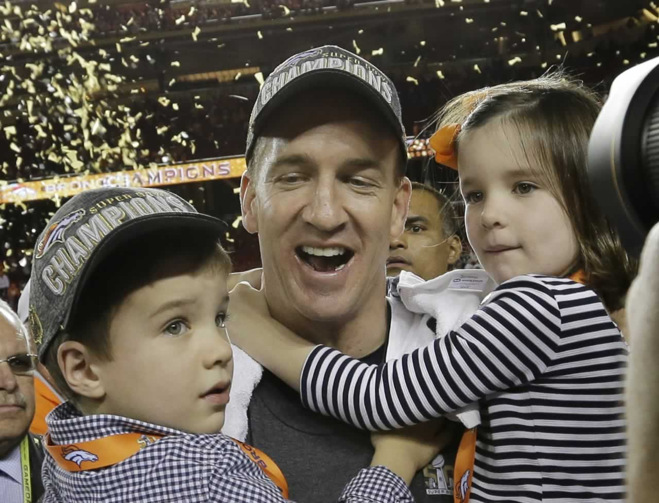 "<div class=""meta image-caption""><div class=""origin-logo origin-image none""><span>none</span></div><span class=""caption-text"">Broncos' Peyton Manning celebrates with his son Marshall and daughter Mosley after the NFL Super Bowl 50 football game Sunday, Feb. 7, 2016, in Santa Clara, Calif. (AP Photo/David J. Phillip)</span></div>"