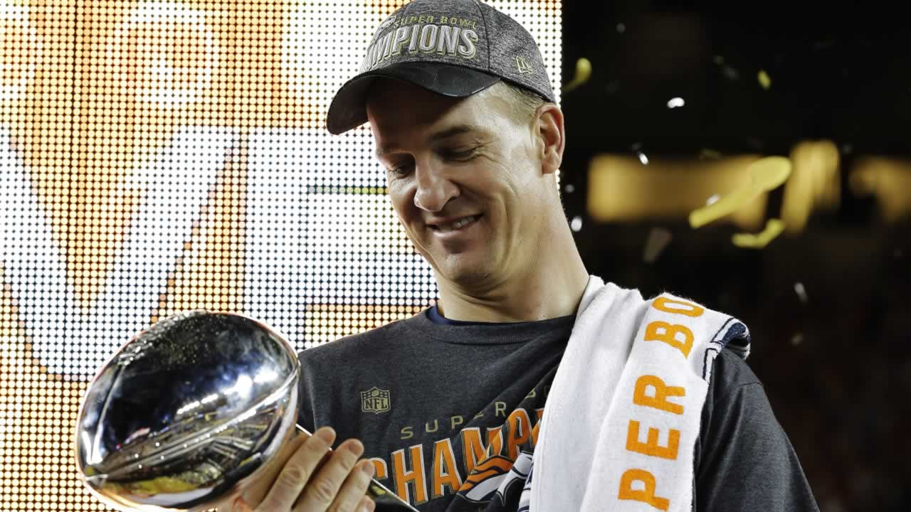 "<div class=""meta image-caption""><div class=""origin-logo origin-image none""><span>none</span></div><span class=""caption-text"">Broncos' Peyton Manning holds up the trophy after the NFL Super Bowl 50 football game Sunday, Feb. 7, 2016, in Santa Clara, Calif. (AP Photo/David J. Phillip)</span></div>"