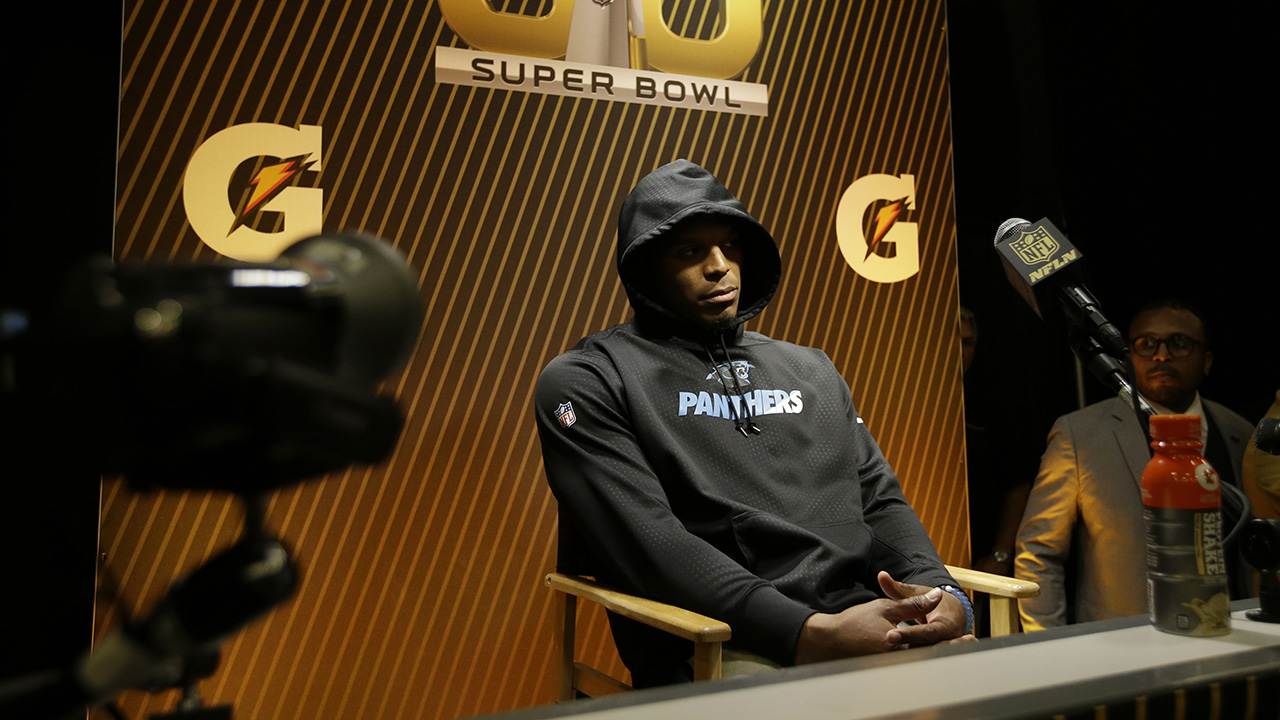 Carolina Panthers' Cam Newton answers questions after the NFL Super Bowl 50 football game against the Denver Broncos Sunday, Feb. 7, 2016, in Santa Clara, Calif.