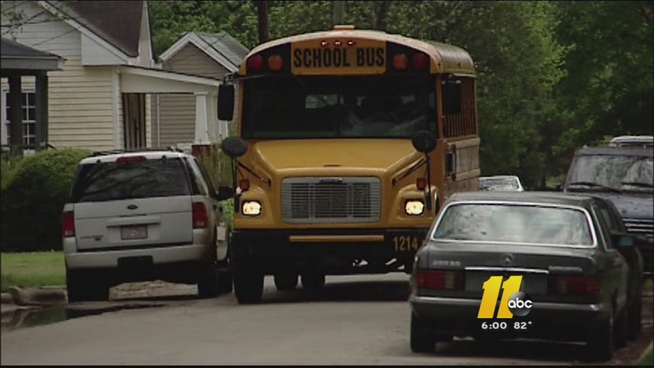 Wake County school bus traveling down residential street.