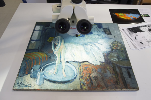 "<div class=""meta image-caption""><div class=""origin-logo origin-image ""><span></span></div><span class=""caption-text"">""The Blue Room,"" one of Pablo Picasso's first masterpieces sits under a microscope at The Phillips Collection, on Tuesday, June 10, 2014, in Washington. (AP Photo/ Evan Vucci)</span></div>"