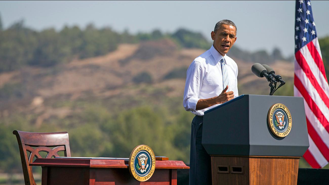 In this Oct. 10, 2014 ,file photo, President Barack Obama speaks at Frank G. Bonelli Regional Park in San Dimas, Calif.