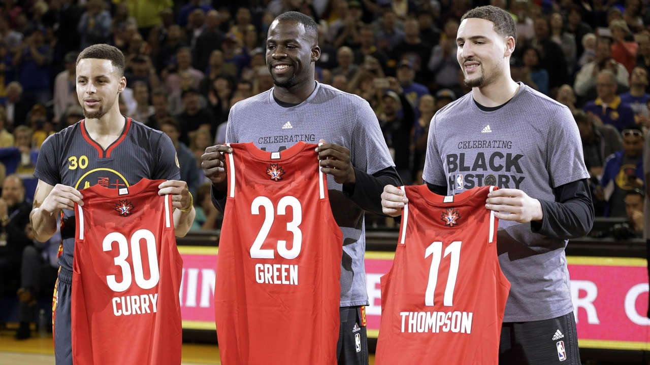 Golden State Warriors' Stephen Curry, Draymond Green, and Klay Thompson display their All Star Game jerseys Tuesday, Feb. 9, 2016, in Oakland, Calif. (AP Photo/Ben Margot)