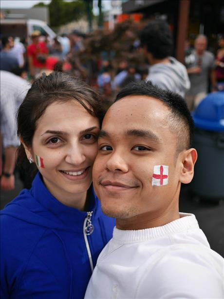 "<div class=""meta image-caption""><div class=""origin-logo origin-image ""><span></span></div><span class=""caption-text"">Mikhak and Kent cheer on Italy and England at SoMa StrEat Food Park in SF. World Cup celebrations are happening all around the Bay Area. Send your photos to uReport@kgo-tv.com! (photo submitted by Kent via uReport)</span></div>"