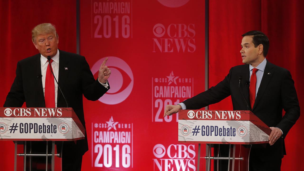 Republican presidential candidate, Donald Trump left, speaks to Republican presidential candidate, Sen. Marco Rubio, R-Fla., during the CBS News Republican debate Feb. 13, 2016.