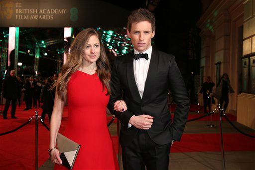 "<div class=""meta image-caption""><div class=""origin-logo origin-image none""><span>none</span></div><span class=""caption-text"">Hannah Bagshawe and Eddie Redmayne pose for photographers upon arrival. (Jonathan Short)</span></div>"