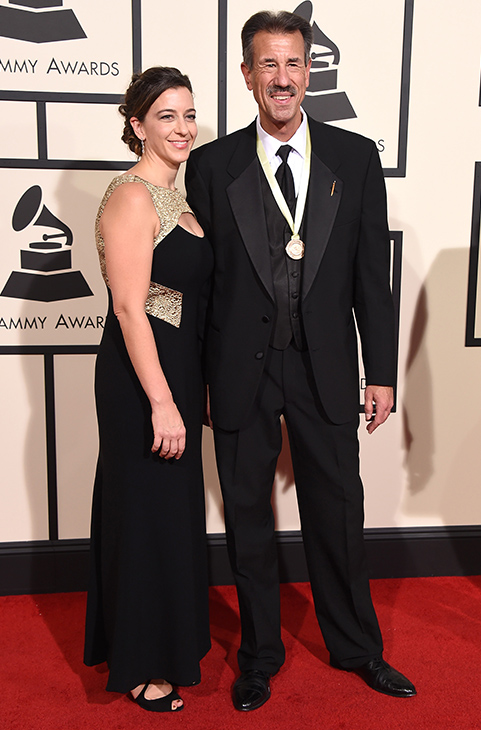 "<div class=""meta image-caption""><div class=""origin-logo origin-image ap""><span>AP</span></div><span class=""caption-text"">John Fedchock, right, and guest arrive at the 58th annual GRAMMY Awards at the Staples Center on Monday, Feb. 15, 2016, in Los Angeles. (Jordan Strauss/Invision/AP)</span></div>"