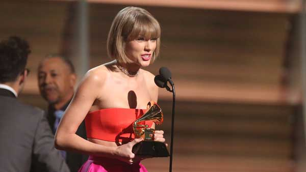 "Taylor Swift accepts the award for album of the year for ""1989"" at the 58th annual Grammy Awards in Los Angeles."