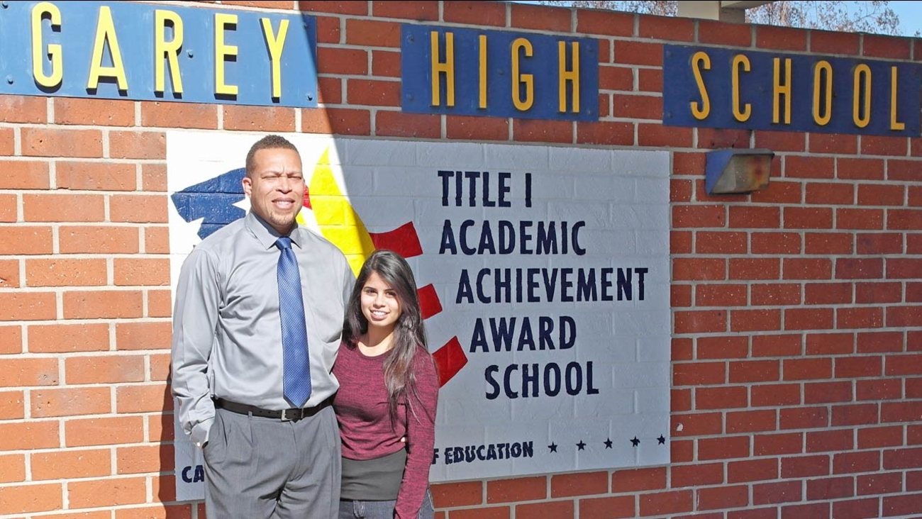 Garey High School senior Karina Aguilar stands with Principal Stacey Wilkins in front of the school in Pomona, California.