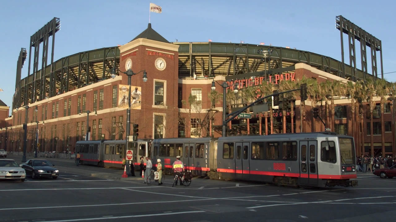 A MUNI streetcar rolls past the brick facade of the new Pacific Bell Park in San Francisco, in this March 31, 2000 photo. (AP Photo/Eric Risberg)