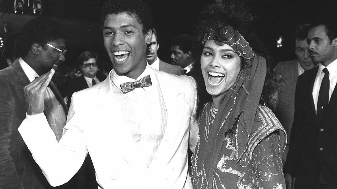 """In this March 22, 1985 photo, actor Taimak, left, and Vanity arrive at the Century Plitt Theater for the premiere of their film """"The Last Dragon."""""""