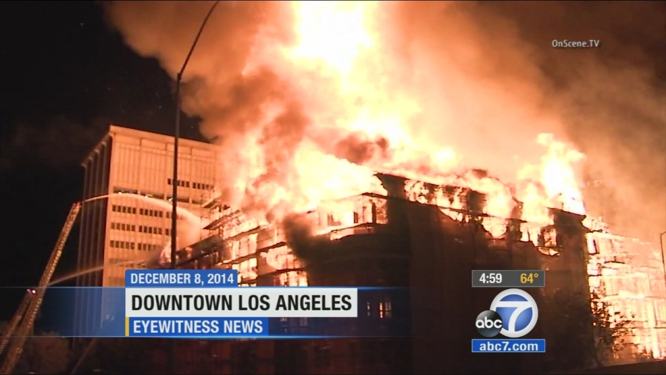 The Da Vinci Apartments are shown engulfed in flames in downtown Los Angeles in December 2014.