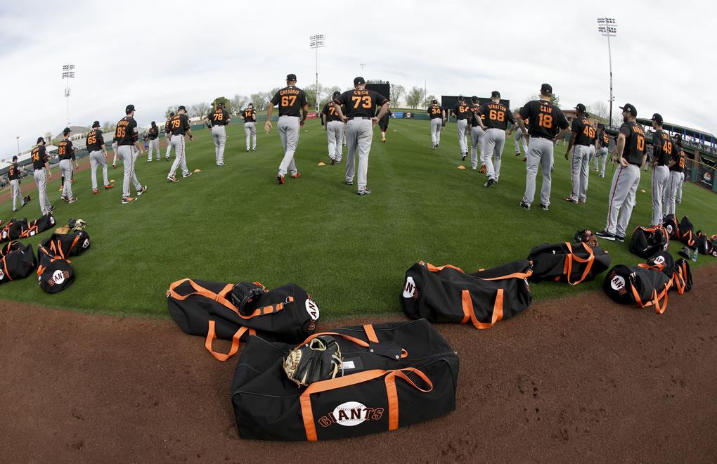"<div class=""meta image-caption""><div class=""origin-logo origin-image none""><span>none</span></div><span class=""caption-text"">Members of the San Francisco Giants warm up before spring training baseball practice in Scottsdale, Ariz., Thursday, Feb. 18, 2016. (AP Photo/Chris Carlson)</span></div>"