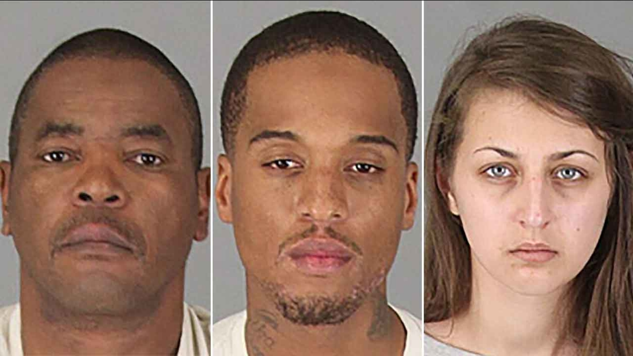 James Wilson (left), Obie McCray (center) and Samantha Ronson (right), all of Lake Elsinore, were arrested for allegedly printing and using counterfeit bills.