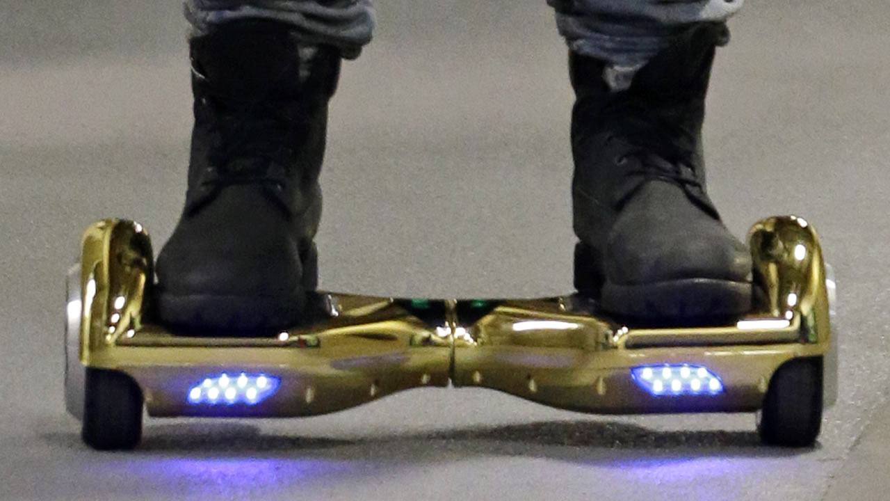 In this Oct. 5, 2015, file photo, Seattle Seahawks wide receiver B.J. Daniels rides through a hallway at CenturyLink Field on an electric self-balancing scooter.