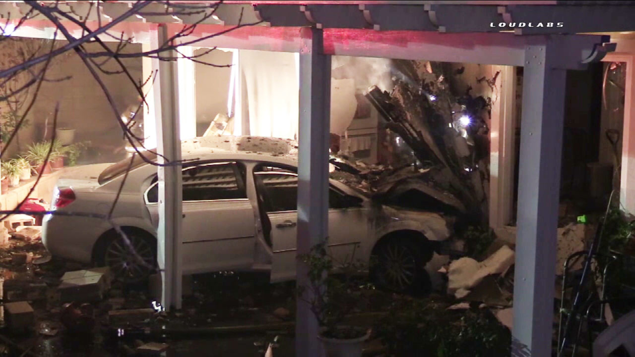 A car slammed into a home in Eastvale, causing five people to be displaced from the residence on Monday, Feb. 22, 2016.