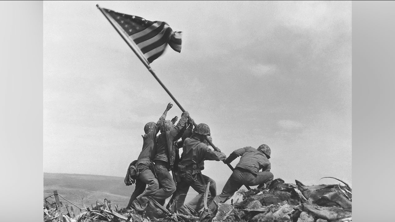 U.S. Marines of the 28th Regiment, 5th Division, raise the American flag atop Mt. Suribachi, Iwo Jima, on Feb. 23, 1945.