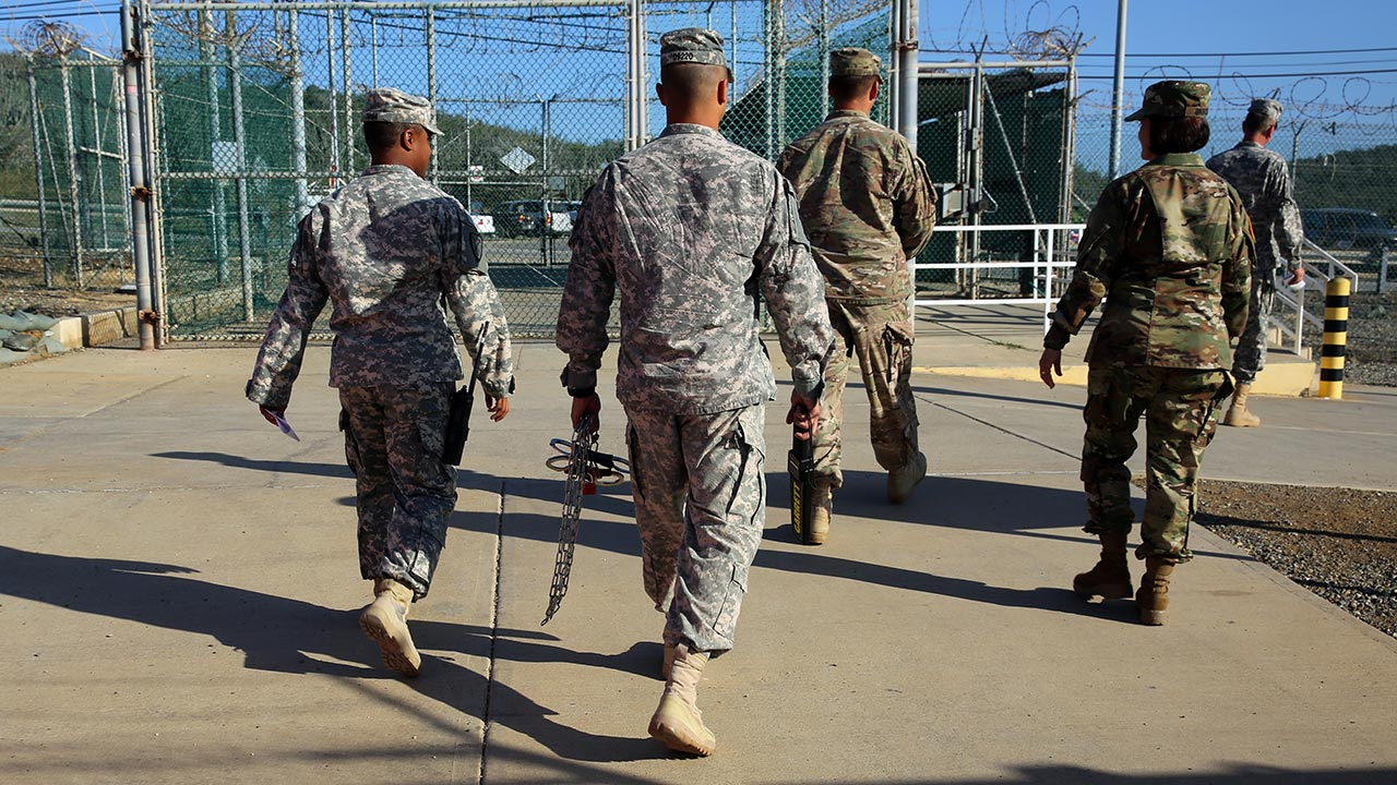 Military guards exit an area known as Camp Delta at the Guantanamo Bay detention center, in Cuba.