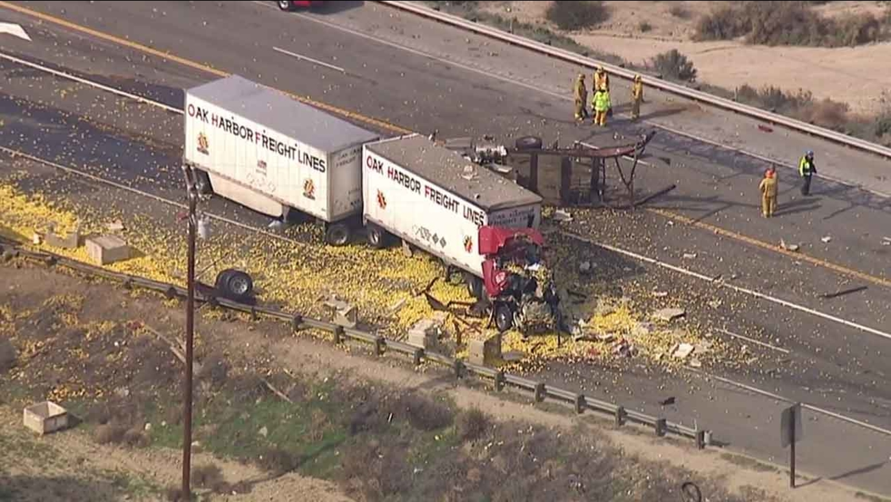 Los Angeles County firefighters respond to a fatal crash involving a car and two tractor trailers on Highway 126 near Chiquito Canyon Road in Castaic Tuesday, Feb. 23, 2016.