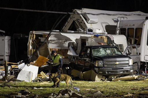 "<div class=""meta image-caption""><div class=""origin-logo origin-image none""><span>none</span></div><span class=""caption-text"">First responders search the remains of trailers and vehicles after a suspected tornado hit the Sugar Hill RV Park in Convent, La. (AP Photo/Max Becherer)</span></div>"