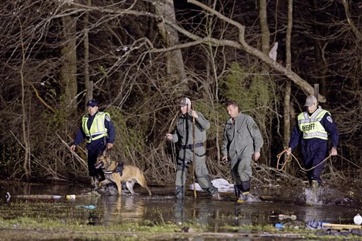 "<div class=""meta image-caption""><div class=""origin-logo origin-image none""><span>none</span></div><span class=""caption-text"">Search and rescue teams slog through the remains of a RV park after a suspected tornado hit the Sugar Hill RV Park in Convent, La., Tuesday, Feb. 23, 2016. (AP Photo/Max Becherer)</span></div>"