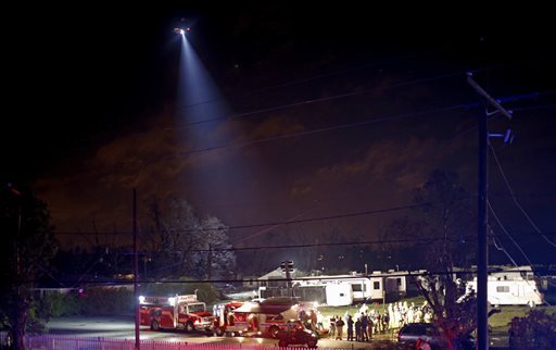 "<div class=""meta image-caption""><div class=""origin-logo origin-image none""><span>none</span></div><span class=""caption-text"">A helicopter and first responders search the remains of trailers and vehicles after a suspected tornado hit the Sugar Hill RV Park in Convent, La. (AP Photo/Max Becherer)</span></div>"