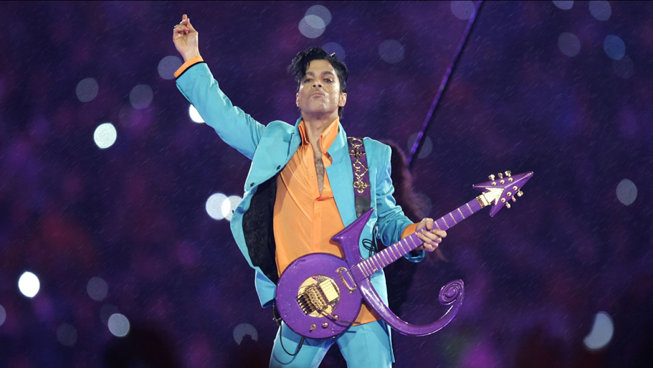 In this Feb. 4, 2007 file photo, Prince performs during the halftime show at the Super Bowl XLI football game at Dolphin Stadium in Miami.