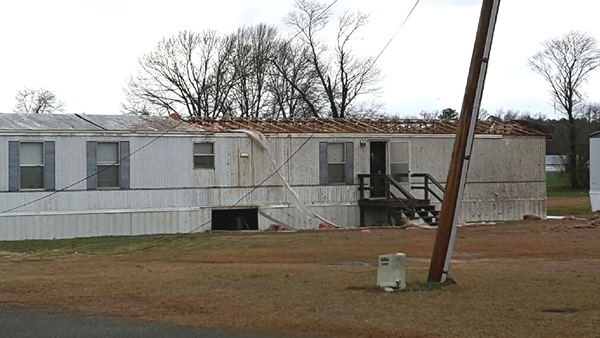 "<div class=""meta image-caption""><div class=""origin-logo origin-image none""><span>none</span></div><span class=""caption-text"">Storm damage in Wayne County</span></div>"