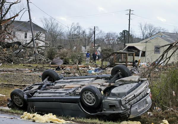 "<div class=""meta image-caption""><div class=""origin-logo origin-image ap""><span>AP</span></div><span class=""caption-text"">An overturned car rest on a highway next to the foundation of a mobile home that was throw across the highway by a deadly storm that swept through Waverly, Va., Wednesday, Feb. 24. (Steve Helber)</span></div>"