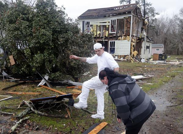 <div class='meta'><div class='origin-logo' data-origin='AP'></div><span class='caption-text' data-credit='Steve Helber'>Rahim Logan, left, and Antoinette Bendrick clear debris from driveway in front of their damaged home after a deadly storm that swept through Waverly, Va., Wednesday, Feb. 24.</span></div>
