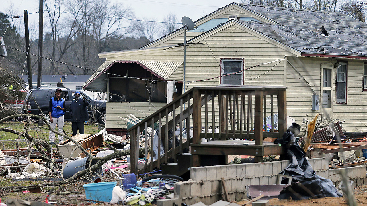 Stairs and a destroyed foundation is all that is left from a mobile home that was carried across a highway by a deadly storm that swept through Waverly, Va., Wednesday, Feb. 24.