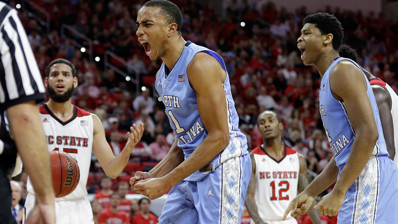 North Carolina's Brice Johnson, center, and Isaiah Hicks, right, react following a play as North Carolina State's Cody Martin looks on at left