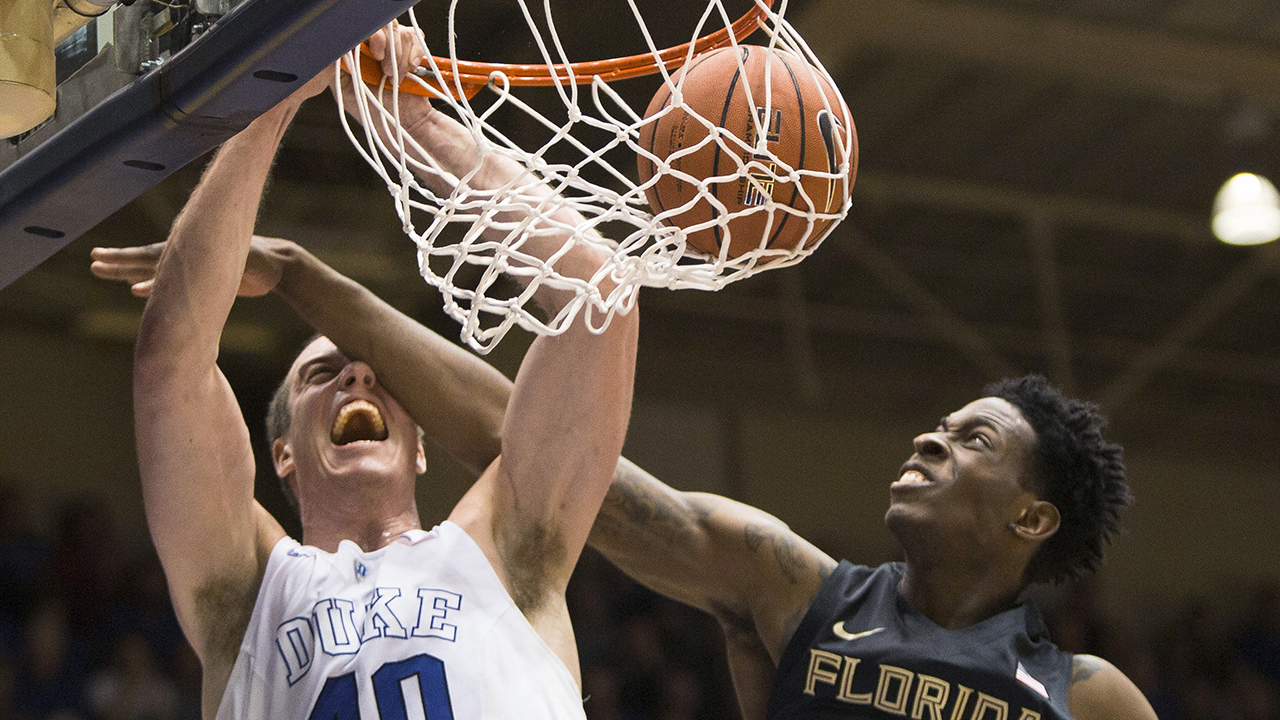 Marshall Plumlee dunks for two of his 13 points for Duke.