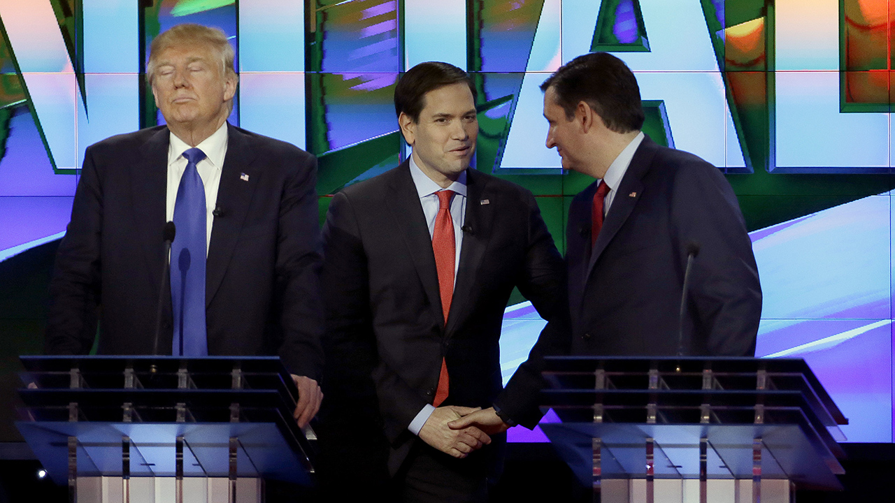 Donald Trump, left, was constantly counter-defending against verbal assaults from Marco Rubio, center, and Ted Cruz on Thursday night in Houston.